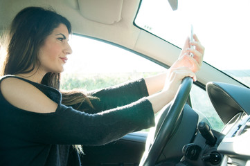 girl in the car with a smart phone