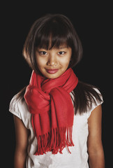 Beautiful Tanned Asian girl in a red scarf