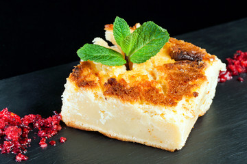 Portion of cheese cake.