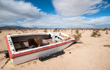 old abandoned boat in the desert