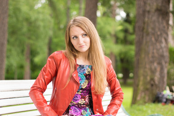 portrait of a beautiful girl on a park bench
