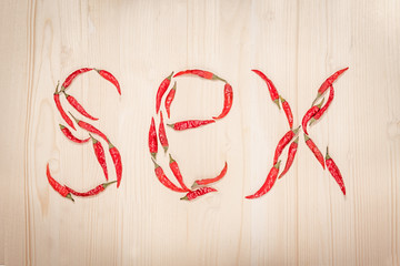 "word ""sex"" composed of chili peppers"