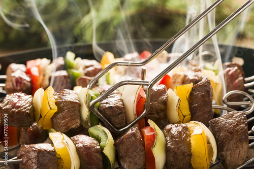 Fototapeta Grilled beef skewers with onions and peppers color.