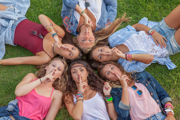 group teens fingers to lips