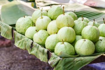 Green guava on banana leave