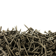 A lot of black drywall screws on a white background