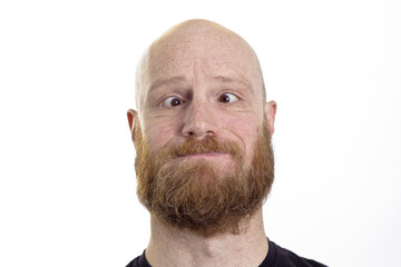 silly bald man with red beard and crossed eyes