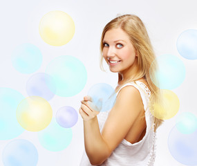 Young woman playing with bubbles.