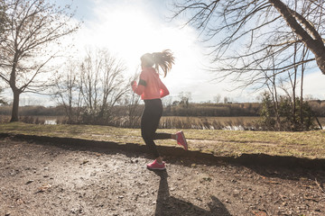 Young Woman Jogging on Off Road Path in the Morning.