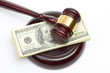 Leinwanddruck Bild - Law gavel on a stack of American money.