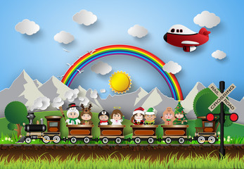 Children in fancy dress sitting on a train running on the tracks