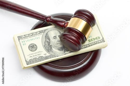 Leinwanddruck Bild Law gavel on a stack of American money.