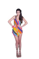 Fashion lady posing in studio wearing colorful mini dress