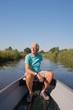 Senior man in motor boat