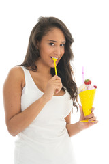 Black woman eating fruit sorbet in glass