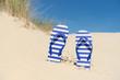 flip flops in sand - 77846329