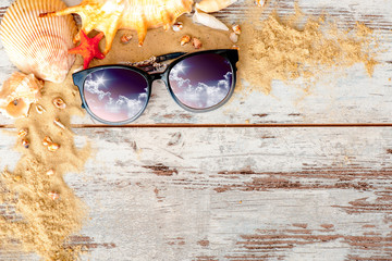 Sea concept composition with sand and eyeglasses