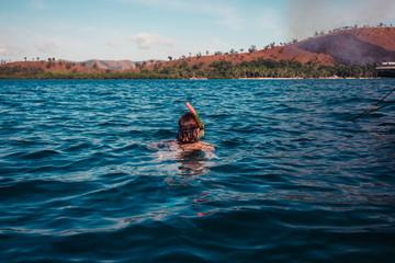 Woman snorkeling near tropical island