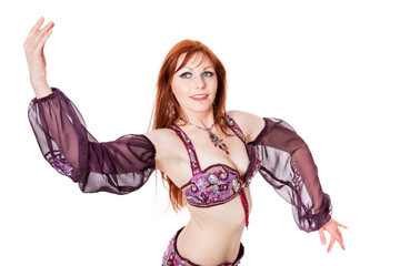 Red-headed belly dancer in dance pose
