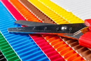 scissors on colorful cardboard
