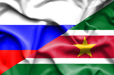Waving flag of Suriname and Russia