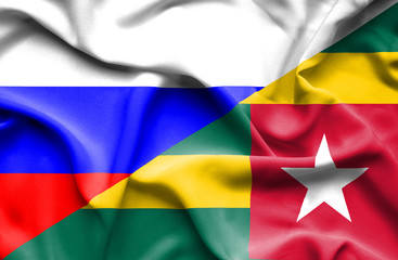 Waving flag of Togo and Russia