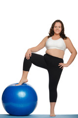 stout woman with blue ball fitness