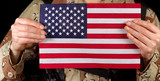 American flag being held by male soldier - 77853190