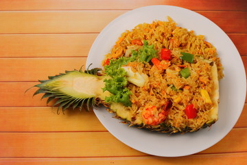 baked rice and seafood in pineapple