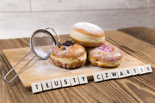 Jummy donuts on wooden table