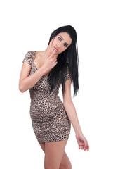 Beautiful fashion model in leopard dress on white background