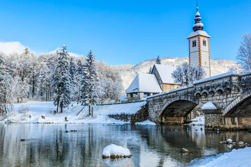 Church of St. John the Baptist by the Bohinj lake at winter