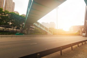Small truck speeding under industrial bridges