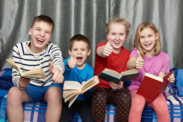 Happy children with books at home