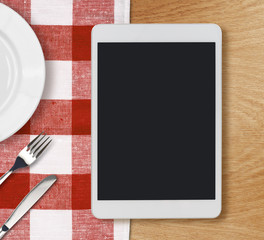 tablet pc on dinner table