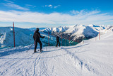 Father and son skiing.