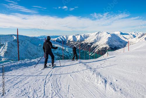 Fototapeta Father and son skiing.