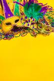 Mardi Gras Mask on yellow Background