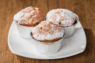 homemade muffins over wooden board selective focus