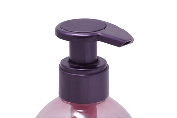 purple bottle for liquid soap from a dispenser. Close up.