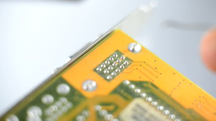 Engineer is making electronic board on a white background