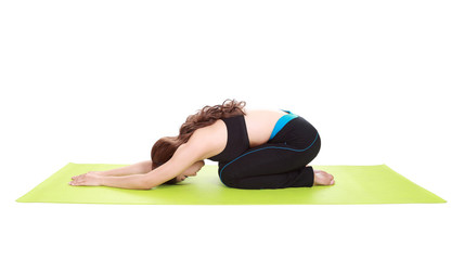 Young woman doing yoga exercise with yoga mat