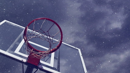 Basketball hoop with cage with snowfall