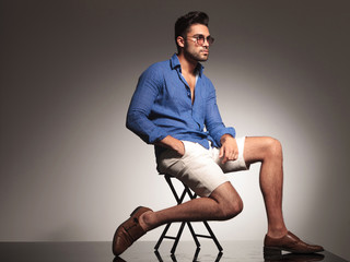 Attractive young fashion man sitting on a chair