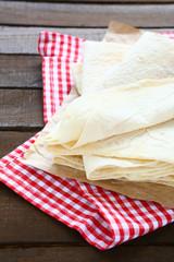 Freshly baked pitas on a napkin