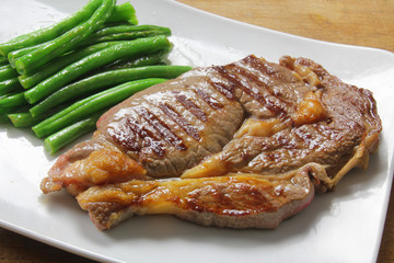 large beef steak with green beans