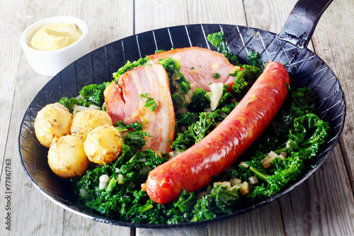 Foto op Canvas Klaar gerecht Gourmet German Cuisine on Pan with Mustard on Side