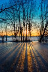 Sunset on frozen pond
