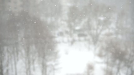 Winter blur background with snowflakes in motion