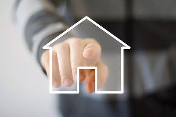 Man with touchscreen house icon